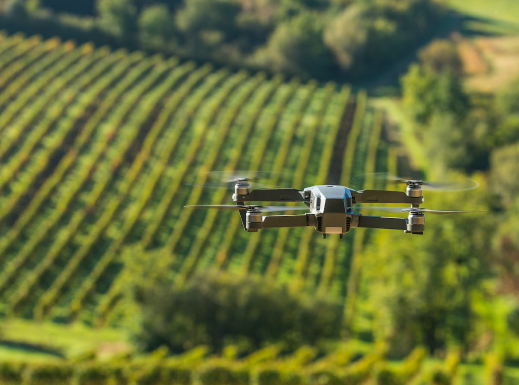 drone flying above farm land